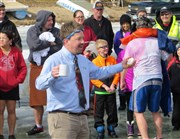 Churches take the (polar) plunge, raise $16,000 for camp